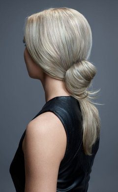 low-messy-half-bun-with-long-ponytail hair up  prom hairstyles and ideas at antonys for hair salon in Bury, manchester